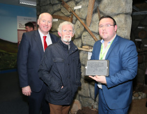 Terence Dever - CEO of CFÁA and John Barrett of the Bervie receiving a presentation from Tommy English, a member of the team developing the offline tablet tours of Achill for the Achill Experience. Photo: © Michael Donnelly